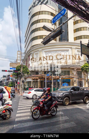 Bangkok, Thailand - 7th March 2017: Traffic passing the Grand China building in Chinatown. The building is both a hotel and a shopping mall. - Stock Image