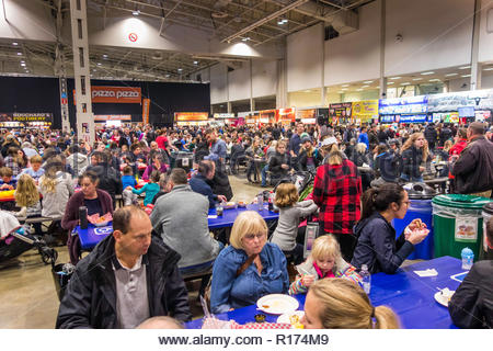 Crowd of people eating lunch in the food court at the Royal Agricultural Winter Fair in Toronto Ontario Canada. - Stock Image
