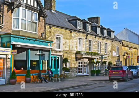 A view of the High Street in Cowbridge with it's  mix of famous brands and small local specialist shops. Showing Oscars coffee shop & The Bear Hotel. - Stock Image