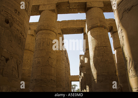 Stone Columns in the Temple of Karnak, Luxor, Egypt, Decorated with Hieroglyphics and Pictures of the Ancient Egyptian - Stock Image