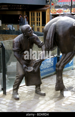 Statue of a Farrier Shoeing a Horse in the New Camden Market Development, London, UK - Stock Image