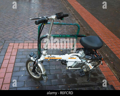 A small high-tec Leyida electric bicycle in a shopping centre in Northern England - Stock Image