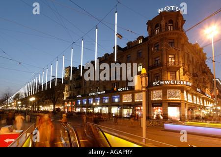 Switzerland Zurich Bahnhofstrasse at twilight Chistmas illumination Hotel Schweizer Hof - Stock Image