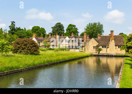 Astor wing with Hever Castle Moat, Hever Castle & Gardens, Hever, Edenbridge, Kent, England, United Kingdom - Stock Image