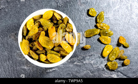 Bowl of Healthy Dried Sultanas Looking Down With No People - Stock Image