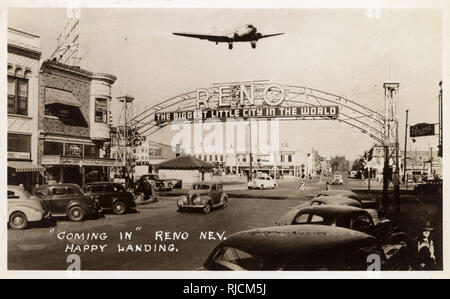 North Virginia Street, Reno, Nevada, USA, with a large sign stretching across the road, The Biggest Little City in the World, and the Stag Inn on the left. - Stock Image