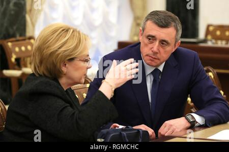 Russian Healthcare Minister Veronika Skvortsova, left, chats with Acting Governor of the Sakhalin Region Valery Limarenko before the start of a meeting hosted by President Vladimir Putin at the Kremlin January 30, 2019 in Moscow, Russia. - Stock Image