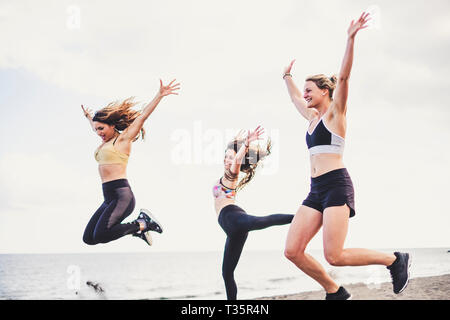Happiness and joyful jump group of young female people in outdoor activity for healthy lifestyle together in friendship - success and team happy at th - Stock Image