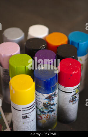 Various coloured spray paint can lids. - Stock Image