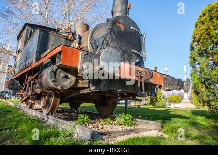 Cordoba, Spain - Feb 16th, 2014: Old steam train engine at Cordoba Park, Spain. Model Anjubault020T 1864 - Stock Image
