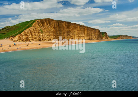 Sandstone cliffs of East cliff at the Dorset seaside town of West Bay. The iconic cliffs are on the Jurassic Coast - Stock Image