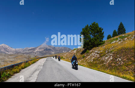 Motor cyclists on a road near Castel del Monte in the Gran Sasso and Monti della Laga National Park, a natural park located mostly in Abruzzo, Italy.  - Stock Image