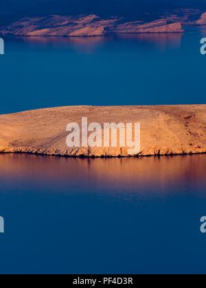 Peaceful small stone island - Stock Image