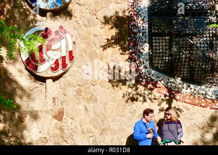 Barcelona, Spain, October 2018. People beside the perimeter wall of Gaudi's Park Guell. - Stock Image