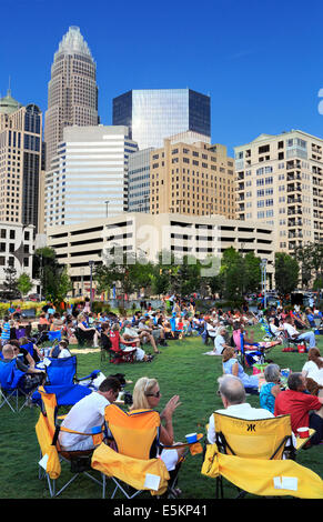 Charlotte, North Carolina. People gathered in Romare Bearden Park for a music event. - Stock Image