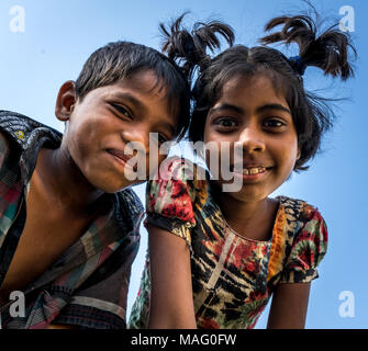 A image of boy and girl captured while I was on expedition to some Indian village in Gujarat, both were quite curious to see digital camera. - Stock Image