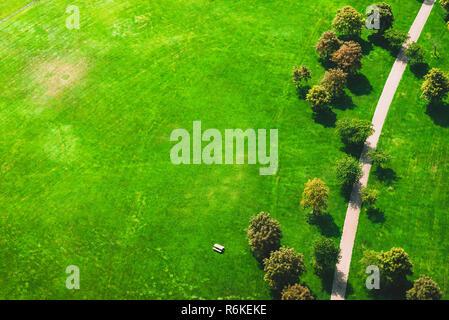 Narrow path through green park, drone's view - Stock Image