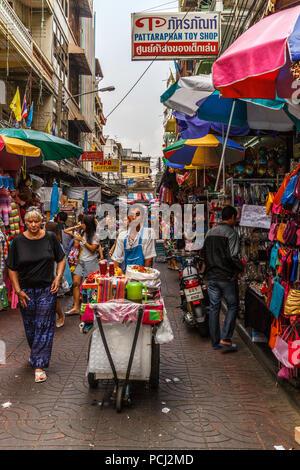 Bangkok, Thailand - 28th November 2014. Street food vendor pushing cart in Chinatown, Food vendors are everywhere. - Stock Image