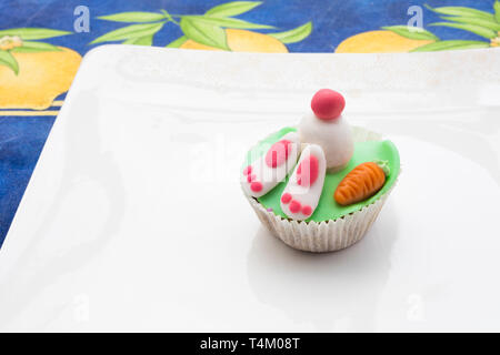 Detail of funny Eastern muffins with rabbit character hiding in the ground. - Stock Image