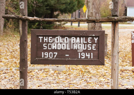 The Old Baily School House sign. 1907-1941. A one-room log schoolhouse built in 1907. It is now part of Sturgeon Point State Park. Harrisville, Michig - Stock Image