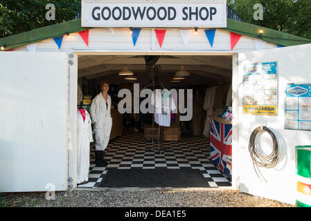 Chichester, West Sussex, UK. 14th Sep, 2013. Goodwood Revival. Goodwood Racing Circuit, West Sussex - Saturday 14th September. The Goodwood Shop a vintage clothing shop complete with shop assistant. Credit:  MeonStock/Alamy Live News - Stock Image