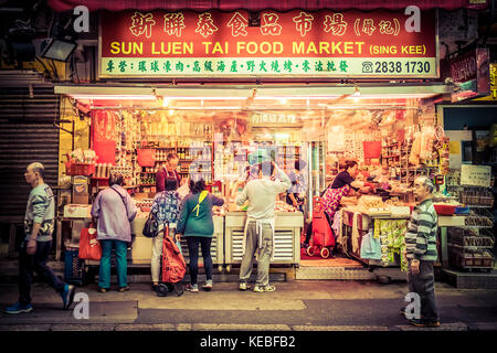 Locals buying food at a local supermarket in Hong Kong - Stock Image