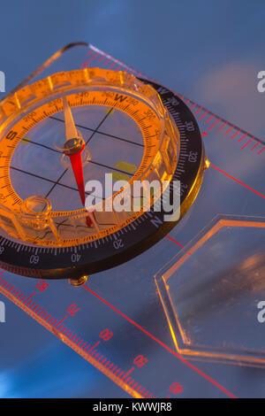 Macro-photo of compass rose face with needle. Outward Bound concept. - Stock Image