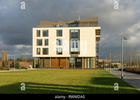 A view across a green space to the Senate House, Waterside Campus, University of Northampton, UK - Stock Image