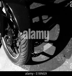 Motorbkie front wheel - Stock Image