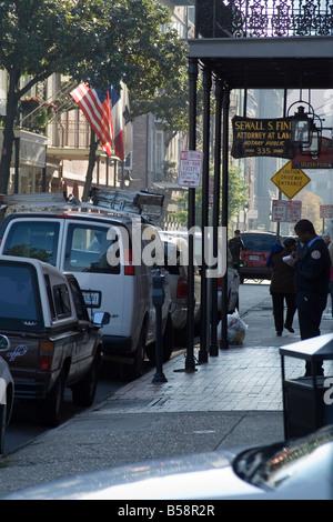 American balcony brick can car city column flag gas hood iron lights meter New Orleans parking paver pedestrian - Stock Image