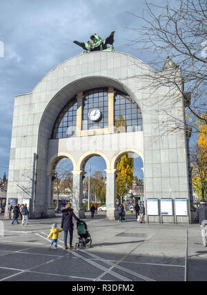 Back side of the historic landmark arch topped by Zeitgeist sculpture (the former entry of the old station that was destroyed by fire in the early 197 - Stock Image