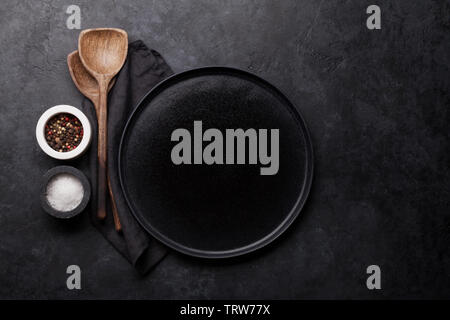 Cooking wooden utensils and empty plate. Food cooking template concept. Top view with copy space. Flat lay - Stock Image