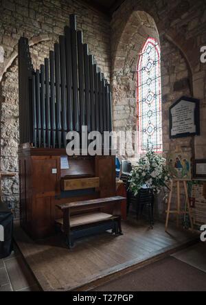 Lindisfarne or Holy Island, Northumberland coast south of Berwick-on-Tweed, England. Parish church of St Mary the Virgin. The organ. - Stock Image
