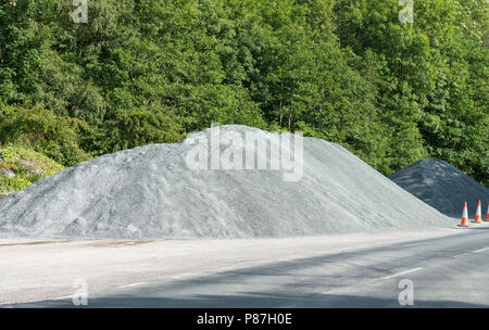 Pile of gravel by the roadside - Stock Image
