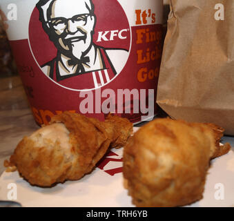 KFC bargain bucket packaging with two original recipe chicken portions - Stock Image