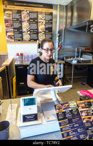 Miami Florida Doral BurBowl restaurant inside employee staff worker Hispanic woman touch screen cash register counter - Stock Image