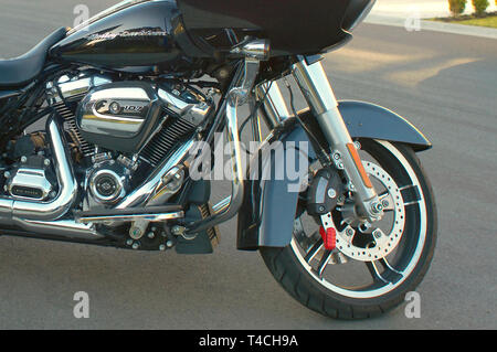 Close up view of the front end of a Harley Davidson motorbike. - Stock Image