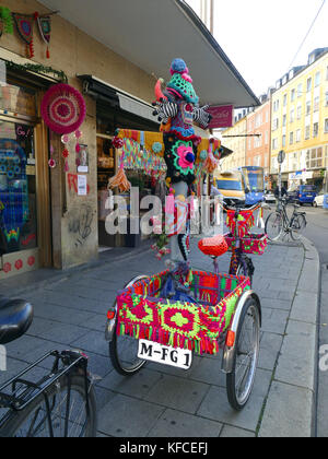 Colorful tricycle Wool supply shop in downtown Munich Germany Europe - Stock Image