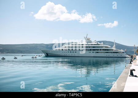 The ship or yacht is moored at the shore and awaits navigation. Summer sea vacation or cruise. - Stock Image