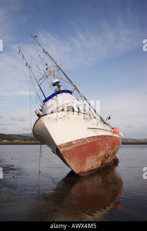 Stranded fishing boat at Pillar Point Harbor, Half Moon Bay, San Mateo County, California, USA - Stock Image