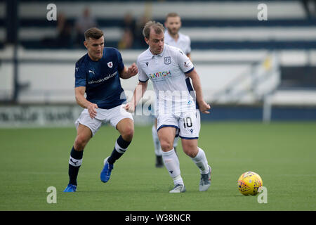 Starks Park, Kirkcaldy, UK. 13th July, 2019. Scottish League Cup football, Raith Rovers versus Dundee; Paul McGowan of Dundee and Ross Matthews of Raith Rovers Credit: Action Plus Sports/Alamy Live News - Stock Image