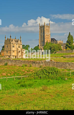 Chipping Campden in the Cotswolds, Gloucestershire and the church tower of St James seen from across farmland on - Stock Image