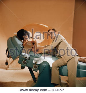 CASINO ROYALE (1967)  Pictured:  Daliah Lavi, Woody Allen.  copyright Columbia Pictures.  Photo courtesy Granamour - Stock Image