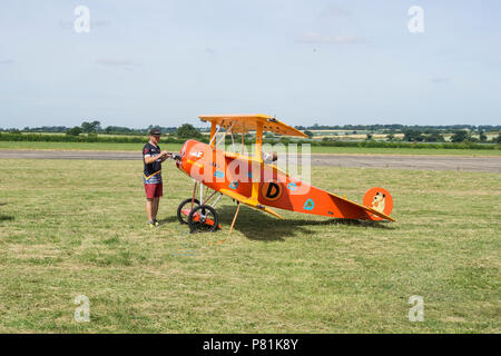 Large model of Fokker Dr.I triplane with builder at Wings and wheels - Stock Image