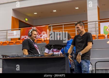 Bielsko-Biala, Poland. 12th Aug, 2017. International automotive trade fairs - MotoShow Bielsko-Biala. Man talking with DJ. Credit: Lukasz Obermann/Alamy Live News - Stock Image