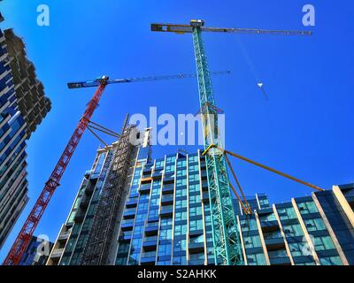 Looking up at the construction of high rise homes and apartments. A growing population means more people who needs more homes. Photo Credit - © COLIN HOSKINS. - Stock Image