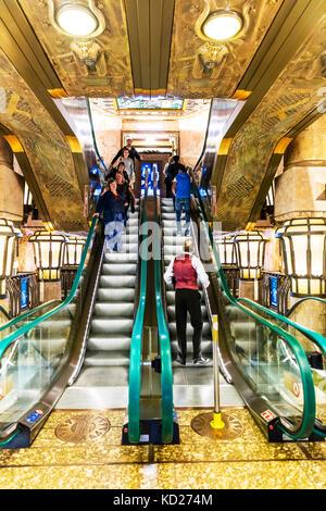 Escalator, using Escalator, people using Escalator, riding Escalator, shop Escalator, store Escalator, Escalators, - Stock Image