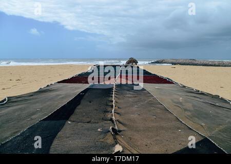 Beach with fishing net in Espinho near Porto, Portugal. - Stock Image