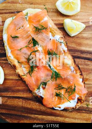 Smoked salmon wood fire pizza with fresh dill and lemon - Stock Image
