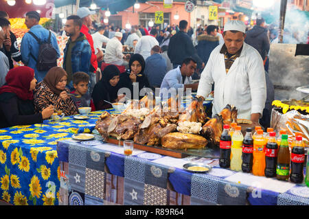 Marrakech street food stalls and people eating, Djemaa el Fna Square, Marrakech, Morocco Africa - Stock Image
